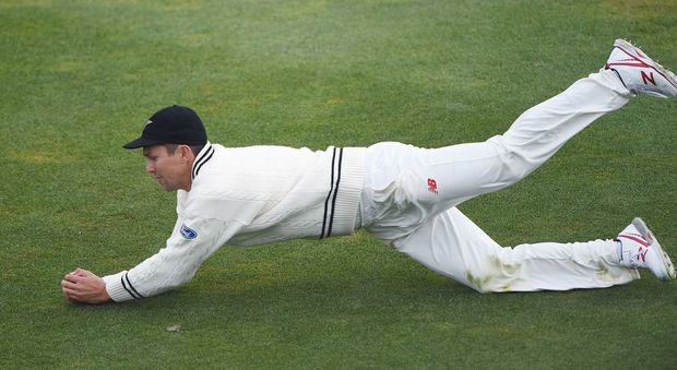 Trent Boult takes a catch to dismiss Rangana Herath on day three of the first cricket Test vs Sri Lanka at University Oval, Dunedin, 12 December 2015. Copyright photo: Andrew Cornaga / www.photosport.nz