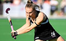 The Black Sticks player Liz Thompson in action.