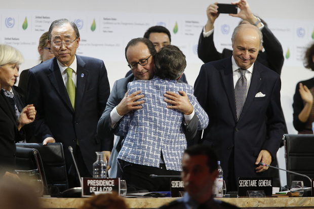 United Nations Framework Convention on Climate Change executive secretary Christiana Figueres and France's President Francois Hollande hug after the adoption of the deal.