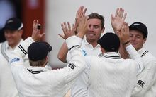 Team-mates congratulate Tim Southee after the dismissal of Ajantha Mendis during play on day 4 of the 1st cricket test match between New Zealand Black Caps and Sri Lanka at University Oval, Dunedin. Sunday 13 December 2015. Copyright photo: Andrew Cornaga / www.photosport.nz