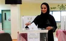 A Saudi woman casts her ballot in a polling station in the coastal city of Jeddah, on December 12, 2015. AFP PHOTO / STR