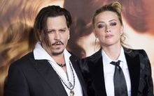 "Actors Johnny Depp (L) and Amber Heard attend the Los Angeles Premiere of ""The Danish Girl"", in Westwood, California, on November 21, 2015."