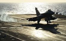 A French Rafale fighter aircraft lands aboard the French Charles-de-Gaulle aircraft carrier