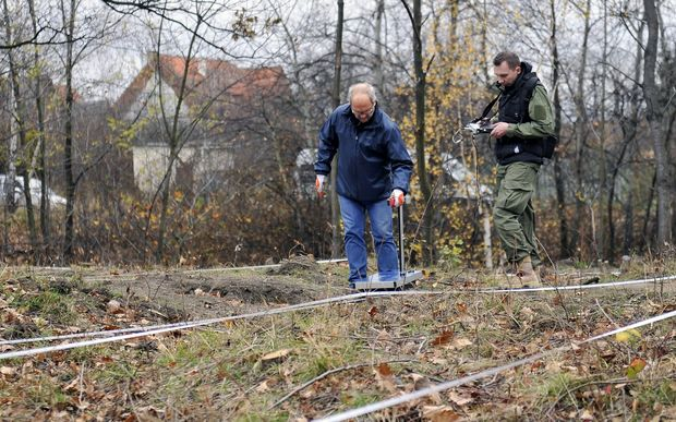 Experts use ground-penetrating radar to inspect an area where a World War II Nazi train is supposed to be hidden in Walbrzych, Poland