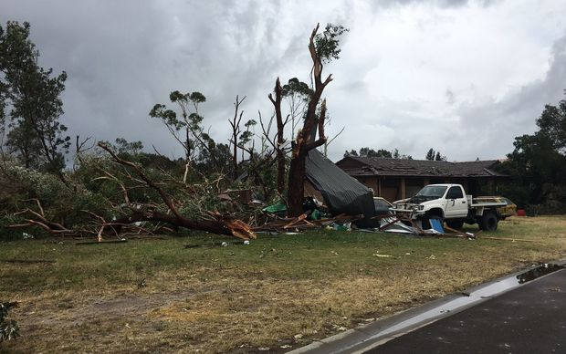 Supplied image obtained Wednesday, Dec. 16, 2015 of the damage caused by severe storm in a street in Kurnell, Southern Sydney