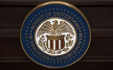 The US Federal Reserve seal. AFP PHOTO/BRENDAN SMIALOWSKI