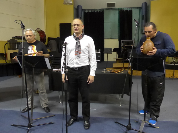Taonga puoro specialists James Webster (left) and Horomona Horo (right) perform a work by and with Charles Royal (centre)