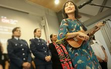Tina Cross performs 'Walk Away' with Counties Manukau police choir and students.