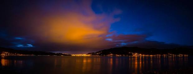 Bright clouds and light reflections on Otago Harbour in Dunedin