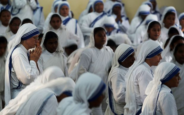 Nuns from the Missionaries of Charity attend mass to commemorate the 105th birthday of Mother Teresa in Kolkata.