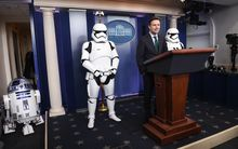 US Press Secretary Josh Earnest speaks to the press in the briefing room at the White House flanked by Star Wars characters R2D2 and Storm Troopers.
