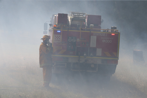 Firefighters battle a bushfire near Wandin, east of Melbourne, in December 2015.