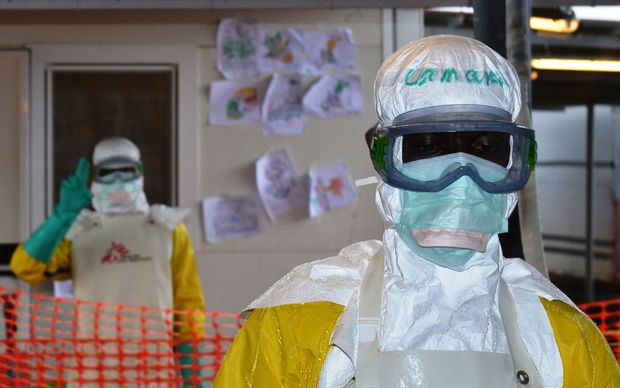 Health workers in protective gear at the Nongo Ebola treatment centre in Conakry, Guinea, in August.