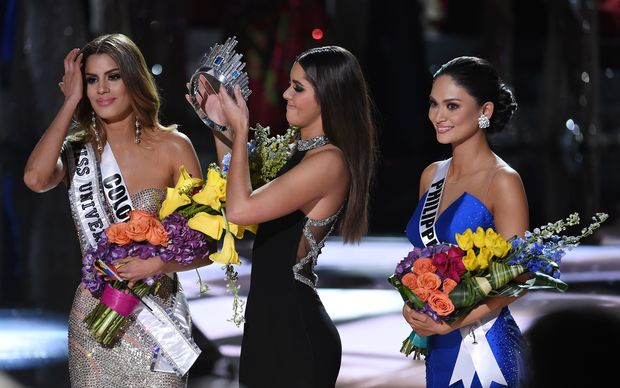 Miss Universe 2014 Paulina Vega, centre, removes the crown from Miss Colombia Ariadna Gutierrez, left, to give it to Miss Philippines Pia Alonzo Wurtzbach.