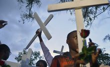 People carry wooden crosses to Freedom Corner in Nairobi in April during a gathering for the victims of an attack claimed by Somalia's Al-Qaeda-linked al-Shabaab insurgents on a university campus in Garissa, Kenya in which 148 people were killed. AFP PHOTO / TONY KARUMBA