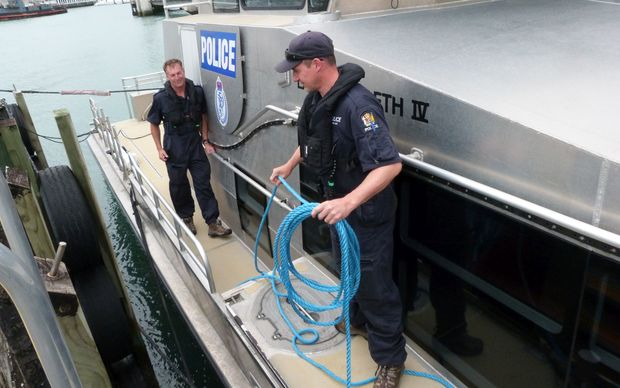Senior Sergeant David Houston, left, and Constable Kyle Smith prepare to leave the berth.