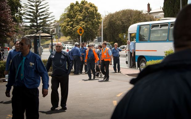 Bus drivers arriving at their stop work meeting at midday today.