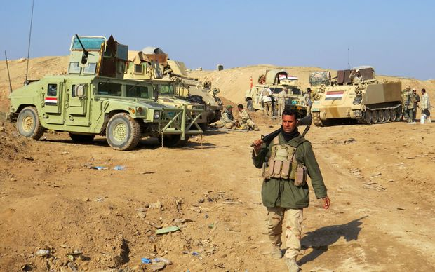 Iraqi pro-government tribal forces hold a position of Ramadi on December 16,
