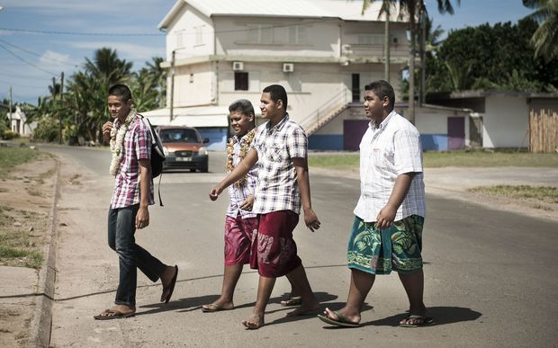 Young men walking in Mata'utu, the biggest town in Wallis and Futuna.