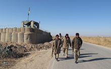 Afghan security forces patrol in the Marjah district of Helmand Province