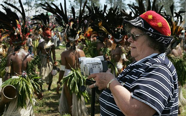 An American tourist video tapes a performance during the annual sing-sing cultural festival in PNG in 2004.