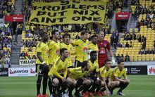 The Wellington Phoenix pose for a team photo in the A-League football match vs Sydney FC at Westpac Stadium on Sunday 19 December 2015. Copyright Photo by Marty Melville / www.Photosport.nz