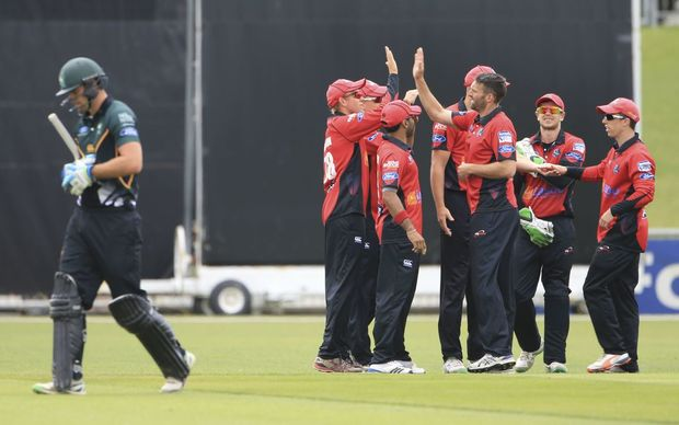 Canterbury celebrate the wicket of Central Districts batsman Tom Bruce at