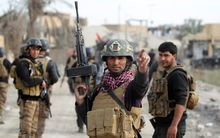 Members of Iraq's elite counter-terrorism service secure the Hoz neighbourhood in central Ramadi.