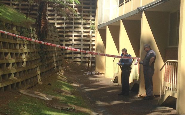 Police conduct a scene examination at the Grey's Avenue apartment block, where a man was found with critical head injuries.