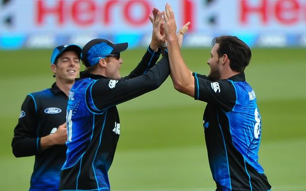 Mitchell Santner (L), Martin Guptill (C) and Mitchell McClenaghan celebrate a wicket during the second ODI vs Sri Lanka, Hagley Oval, Christchurch, 28th December 2015. Copyright Photo: John Davidson / www.photosport.nz