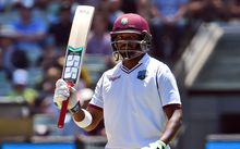 West Indies batsman Darren Bravo acknowledges the applause after scoring his half century against Australia on the third day of the second cricket Test in Melbourne on December 28, 2015. AFP PHOTO / William WEST