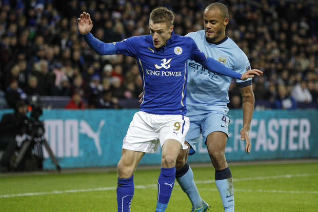 Jamie Vardy of Leicester City is challenged by Vincent Kompany of Manchester City, in December 2014.