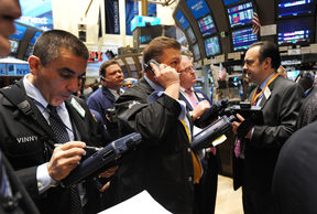 Traders on the floor of the New York Stock Exchange after the opening bell.