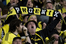 A Phoenix fan yells support during a match at Westpac Stadium in Wellington.