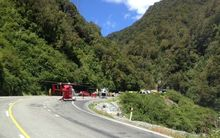 Rescue helicopters at the scene of the crash in the Otira Gorge.