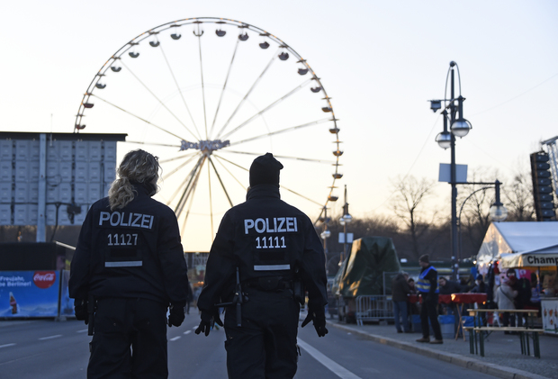 Police patrol at the fair grounds ahead of the New Year's Eve party near the Brandenburg Gate in Berlin.