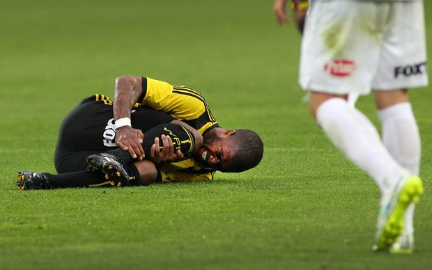 Phoenix star Roly Bonevacia is the most-fouled player in the A-League - here seen injured in the Western Sydney Wanderers match at Westpac Stadium, 28 December 2014. Photo.: Grant Down / www.photosport.co.nz