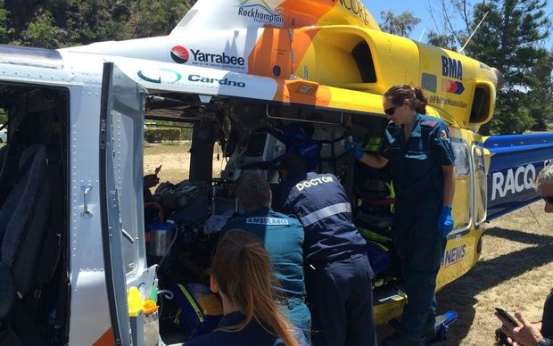 Paramedics treat the 31-year-old man who was attacked by a shark while spearfishing off Yeppoon in central Queensland.