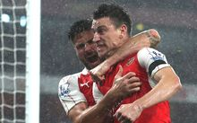 Laurent Koscielny celebrates after scoring a goal for Arsenal.