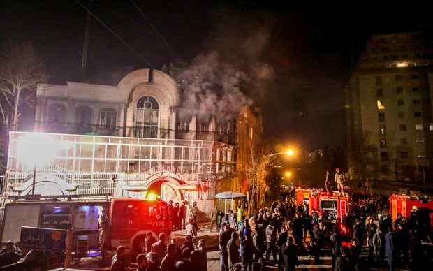Iranian protesters set fire to the Saudi Embassy in Tehran.