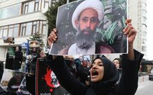 Demonstrators hold pictures of Shiite cleric Sheikh Nimr al-Nimr as they protest outside the Saudi Embassy in Ankara to protest against the execution by Saudi Arabia of the prominent Shiite cleric.