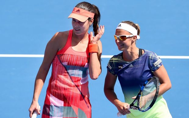 Ana Ivanovic (L) and Kirsten Flipkens  confer during an ASB Classic doubles match, Monday 4 January 2016. Copyright Photo: Chris Symes / www.photosport.nz