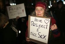 A woman in Cologne protests against sexism, following a mass sexual assault in the city on New Year's Eve.