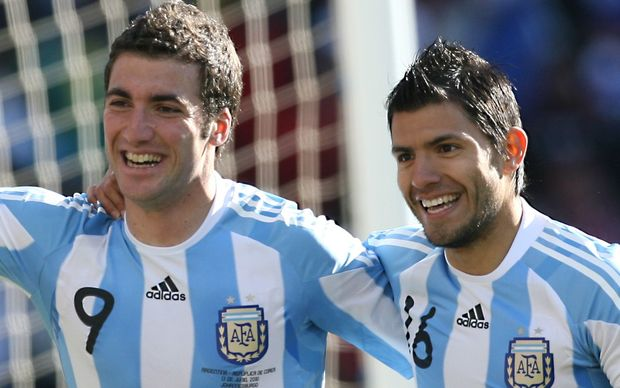 Gonzalo Higuain (L) celebrates with teammate Sergio Aguero after scoring a goal for Argentina.