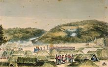 This painting by John Williams shows Ruapekapeka pā in the distance on a hill, with the smoke of gunfire around it. In the foreground on a flat area are British redcoats, some standing in line, some moving amongst raupo 'tents'.