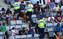 Police take away fans during the Twenty20 match between the Black Caps and Sri Lanka at Eden Park.