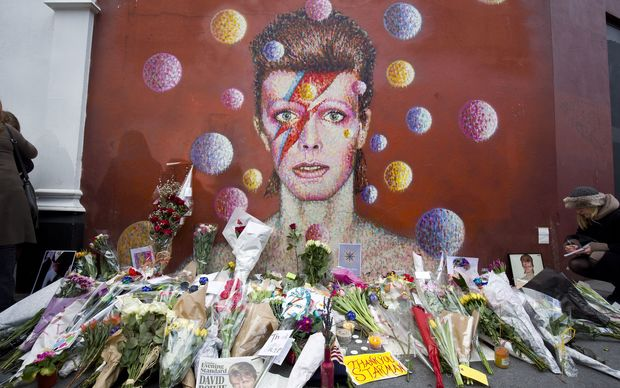 Floral tributes are left beneath a mural of David Bowie painted by Australian street artist James Cochran, aka Jimmy C, in Brixton, South London.
