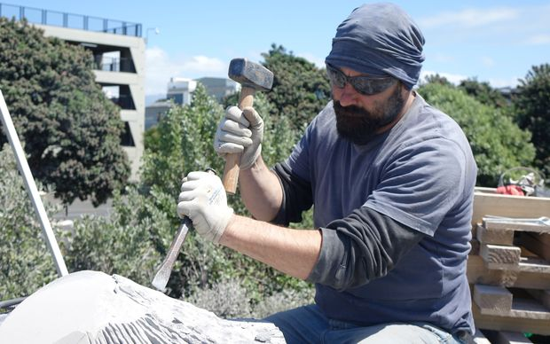 Italian artist Fransesco Panceri at work during the Stone Sculpture Symposium in New Plymouth.