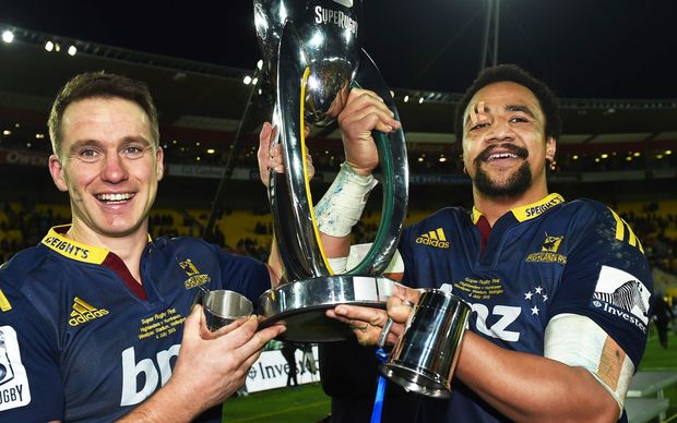 Ben Smith and Nasi Manu hold the Super Rugby trophy aloft after the Highlanders historic win.