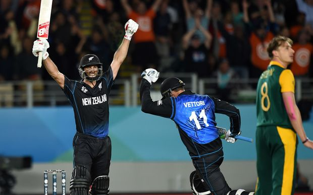 Grant Elliott celebrates hitting the winning runs to put New Zealand into their first Cricket World Cup final.